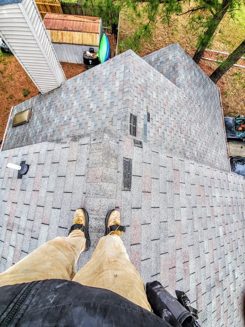 residential roofer standing on pitched roof