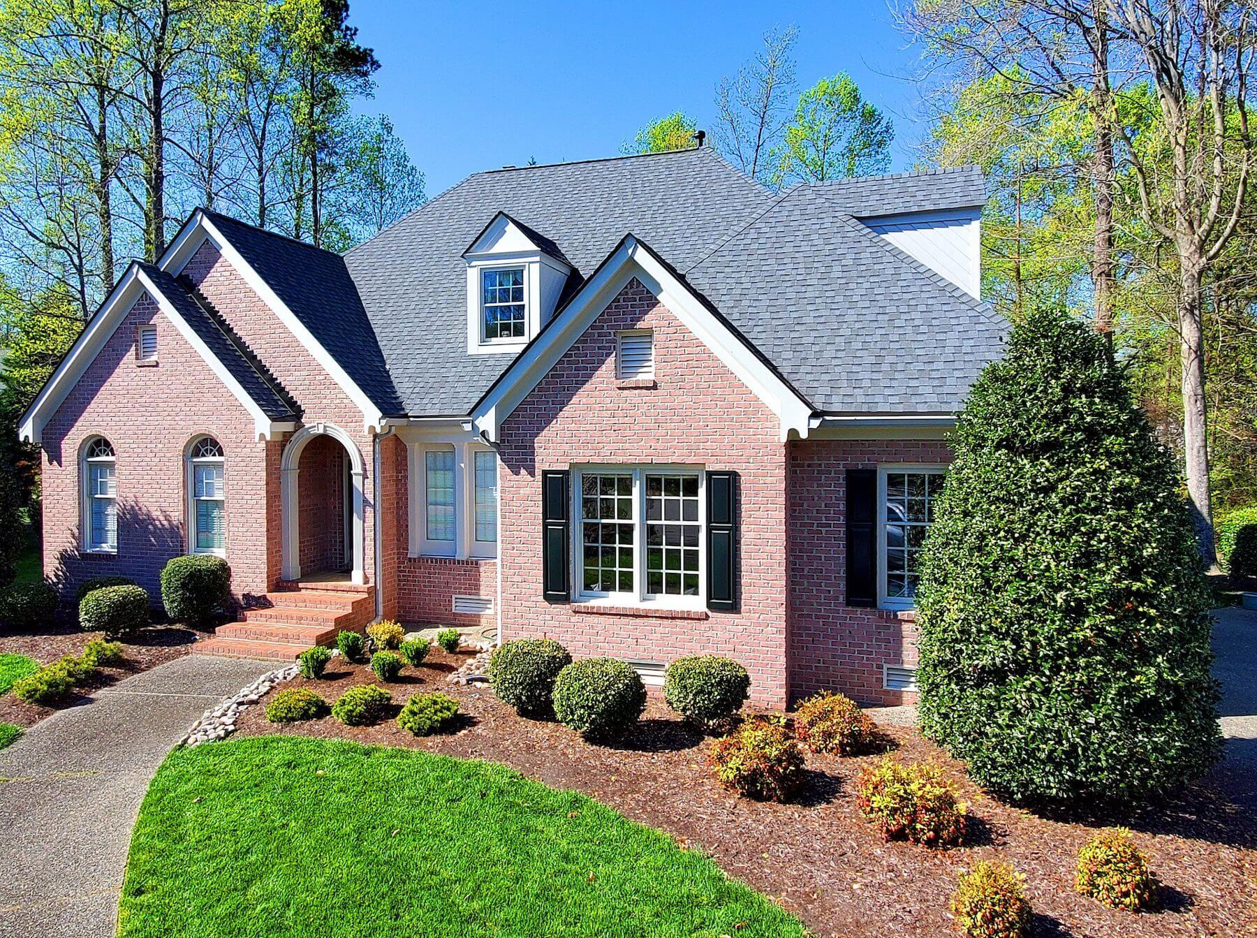 brick home with gray shingles