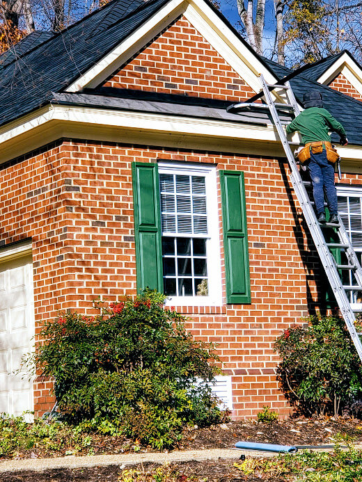 residential roofer on a ladder